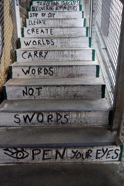 Travelling staircases, discovering universes, step by step, elevate, create worlds, carry words, not swords. Open Your Eyes Graffiti from Kunsthaus Tacheles building in Berlin
